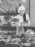 Shopgirl working in bakery Stock Photo