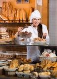 Shopgirl working in bakery Stock Photography