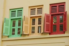 Shophouse windows. Gaily-colored shop house windows Royalty Free Stock Images