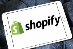 Shopify company logo. Logo of Shopify company on samsung tablet . Shopify is a commerce platform that allows anyone to easily sell online, at a retail location stock images