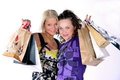 SHOPING. Happy young women with bags Stock Photo