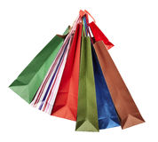 Shoping bag consumerism retail. Collection of shopping bags hanging on white background with clipping path Stock Images