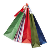 Shoping bag consumerism retail. Collection of shopping bags hanging on white background with clipping path Stock Photo