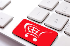 Shoping button. Red button on keyboard with trolley Royalty Free Stock Images