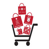 Shoping Cart with Christmas Bags Royalty Free Stock Image