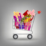 Shoping cart with Christmas gifts. Royalty Free Stock Photos