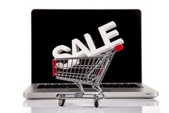 Shoping concept. Computer, basket and free web shoping Stock Photo