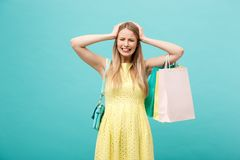 Shoping and Sale Concept: beautiful unhappy young woman in yellow elegant dress with shopping bag. Shoping and Sale Concept: beautiful unhappy young woman in stock photos