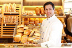 Shopkeeper with basket of bread Stock Photography