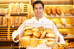 Shopkeeper with basket of bread Royalty Free Stock Photo