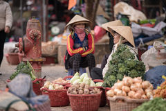 Shopkeeper in the evening markets beside way in Dalat Stock Photo