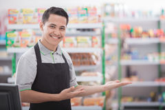 Shopkeeper in a grocery store Stock Photo