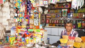Shopkeeper at a Grocery Store Royalty Free Stock Images