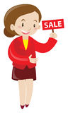 Shopkeeper holding sale sign Stock Photography