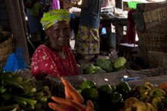 Shopkeeper selling vegetables in Bamako Stock Images