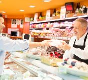 Shopkeeper serving a customer Royalty Free Stock Images