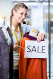 Shopkeeper working at promotion sales Royalty Free Stock Image