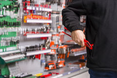 Shoplifter at work Stock Photography