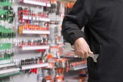 Shoplifter at work Stock Images