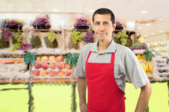 Shopman at the fruitshop Stock Photography