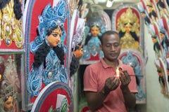 Free Shopowner Burning Incense Sticks For Pooja At Kumartuli,Kolkata,India Royalty Free Stock Photo - 153953435