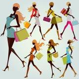 shoppa för flickor Arkivfoto