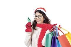 shoppa för jul På bokstäver som hänger julklockor Royaltyfri Foto