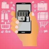 Shoppa på mobil Arkivbild