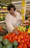 shoppa tomater Arkivfoto