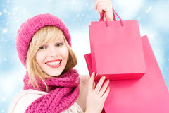 Shopper. Happy teenage girl in hat with pink shopping bags Royalty Free Stock Image