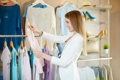 Shopper in boutique Stock Images