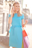 Shopper calling Royalty Free Stock Photography