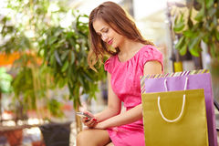 Shopper with cellphone Stock Photo