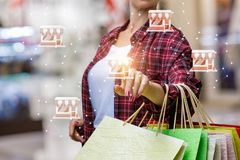 Shopper clicks on the store icon. On blurred background stock photography
