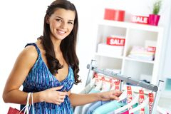 Shopper in clothing department Royalty Free Stock Image