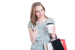 Shopper with coffee and bags showing like sign Royalty Free Stock Photography