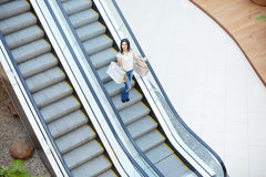Shopper on escalator Stock Photo