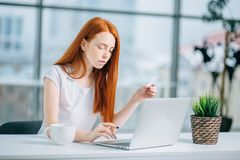 Shopper girl buying online with a laptop and credit card Stock Image