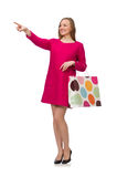 Shopper girl in pink dress holding plastic bags isolated on whit Royalty Free Stock Images