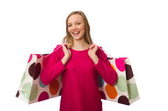 Shopper girl in pink dress holding plastic bags isolated on whit Royalty Free Stock Photo