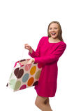 Shopper girl in pink dress holding plastic bags isolated on whit Royalty Free Stock Photography