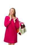 Shopper girl in pink dress holding plastic bags isolated on whit Royalty Free Stock Photos