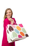 Shopper girl in pink dress holding plastic bags isolated on whit Stock Photos