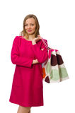 Shopper girl in pink dress holding plastic bags isolated on whit Royalty Free Stock Image