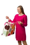 Shopper girl in pink dress holding plastic bags isolated on whit Stock Image