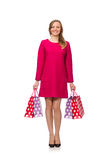 Shopper girl in pink dress holding plastic bags isolated on whit Stock Photography