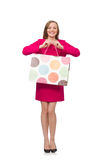 Shopper girl in pink dress holding plastic bags isolated on whit Stock Images