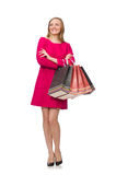 The shopper girl in pink dress holding plastic bags isolated on whit Stock Photos
