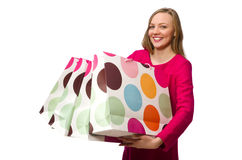 Shopper girl in pink dress holding plastic bags  on whit Stock Photos