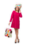 Shopper girl in pink dress holding plastic bags  on whit Royalty Free Stock Photos